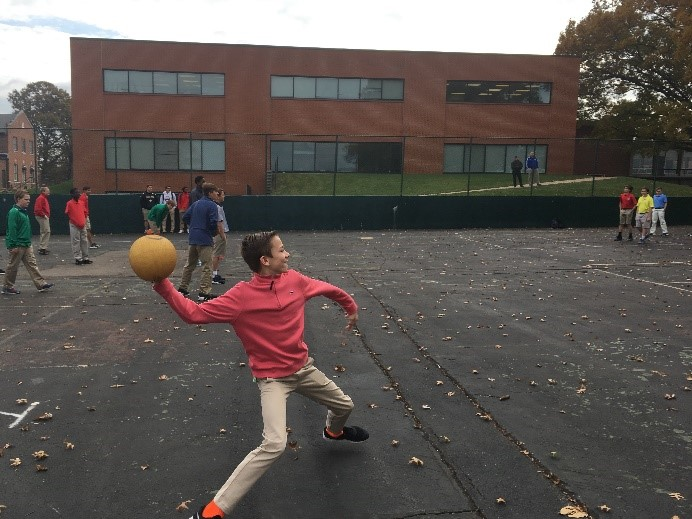 A member of Mr. Master's mentor group winds up to throw the ball