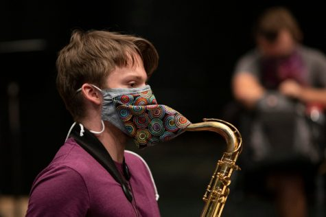 A college student wears a custom-designed mask during rehearsal at Indiana University Jacobs School of Music in Bloomington, Indiana. (Chris Bergin for KHN)